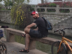 Chris sitting along the canal in the Pingjiang District.